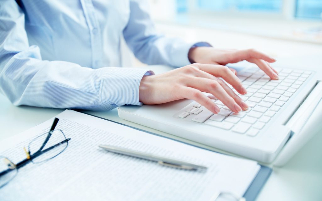 close up woman using laptop